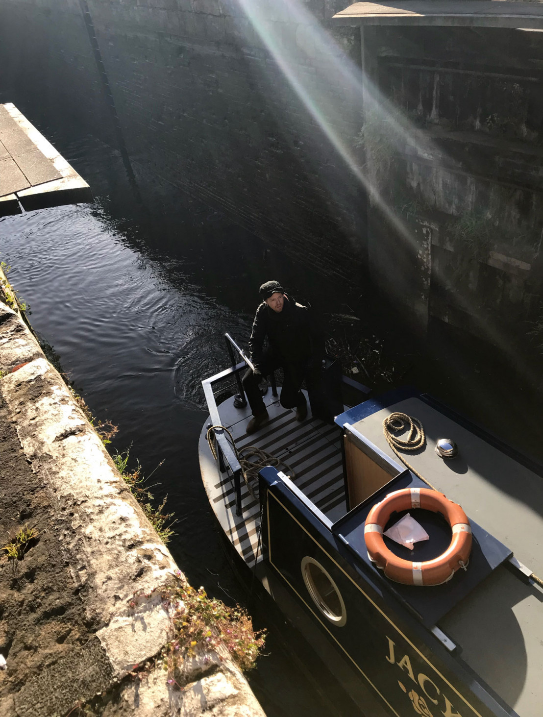 Anthony guiding the boat through the lock