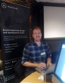 Anthony Hartnell sitting in a chair at the Bristol 2018 do_action WordPress hackathon.